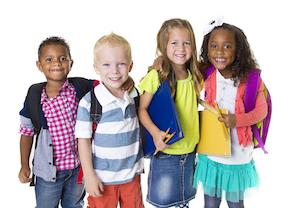 a group of children smiles in front of a white backdrop | children's dentist evansville