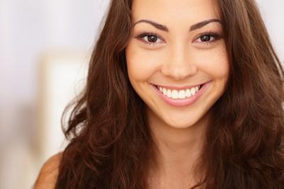 woman smiling with bright smile I cosmetic dentistry in evansville, in
