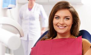 A woman smiles in the dental chair | Preventive Dentistry Melody Hill IN