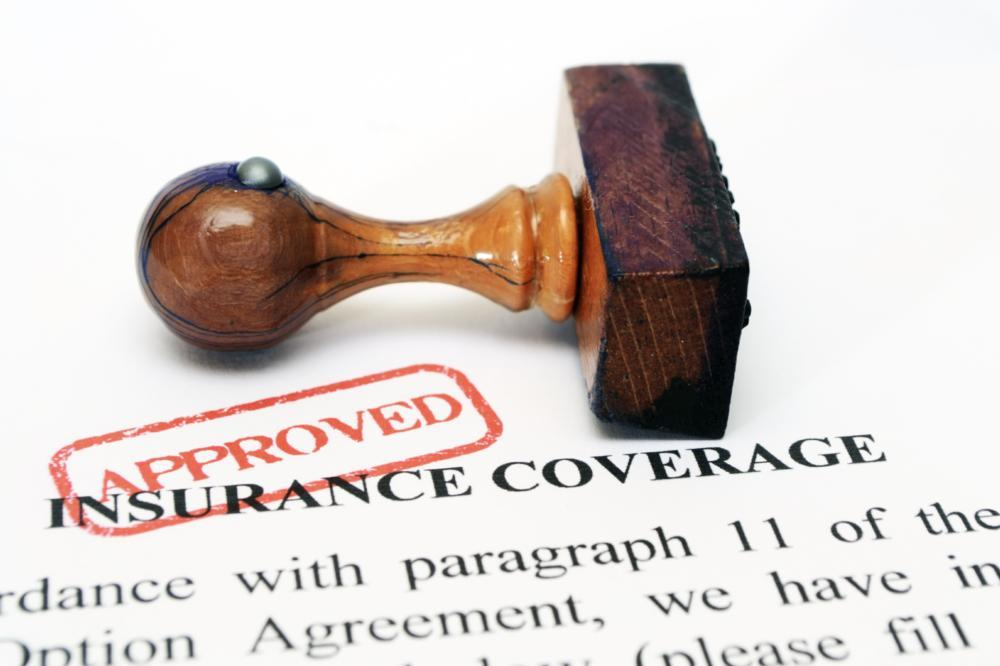 an image of a stamp laying on insurance papers | Insurance Dentist Evansville IN