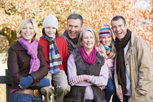 A family smiles in the autumn | Evansville IN general dentist