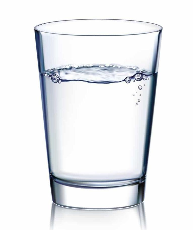 a glass of water in front of a white backdrop | Evansville IN Dentist