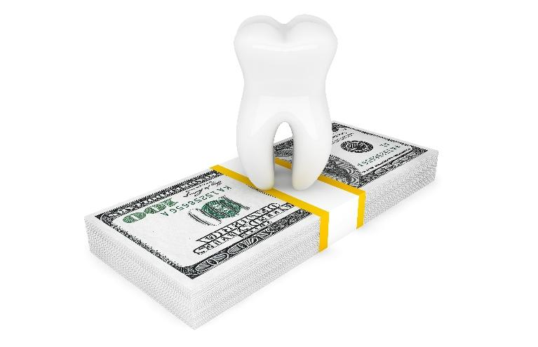 An animated image of a tooth on top of a stack of cash | Evansville IN Insurance Dentist