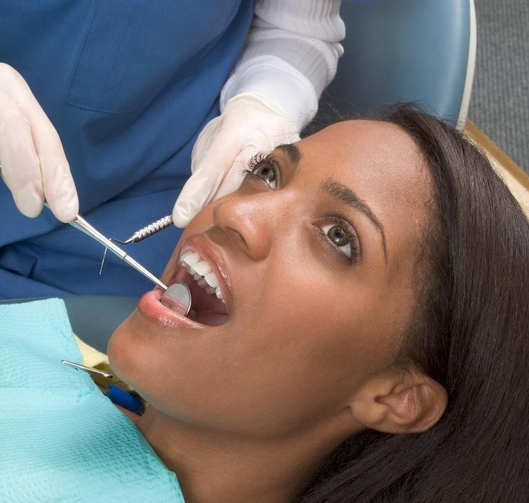 Woman in dental chair | Dentist Evansville IN